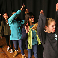 "Sadie Richburg, right, throws her arms in the air as she plays the ""Whoosh game"" with the other girls at the Milam Girls Leadership Academy's first meeting on Wednesday."