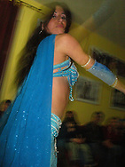 A belly dancer performs at a refugee resettlement group house in Siracusa, Italy, March 2012.