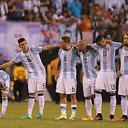 EAST RUTHERFORD, NEW JERSEY - JUNE 26:  Lionel Messi, (left),  #10 of Argentina with team mates on the half way line after missing a penalty in the penalty shoot out during the Argentina Vs Chile Final match of the Copa America Centenario USA 2016 Tournament at MetLife Stadium on June 26, 2016 in East Rutherford, New Jersey. (Photo by Tim Clayton/Corbis via Getty Images)