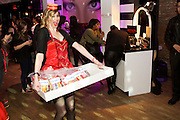 Brooklyn, NY - February 18, 2015: 'Cigarette girls' passed candies from client Mars at the party celebrating Mediacom's winning the title, Agency of the Year. <br /> <br /> CREDIT: Clay Williams for Mediacom.<br /> <br /> &copy; Clay Williams / claywilliamsphoto.com