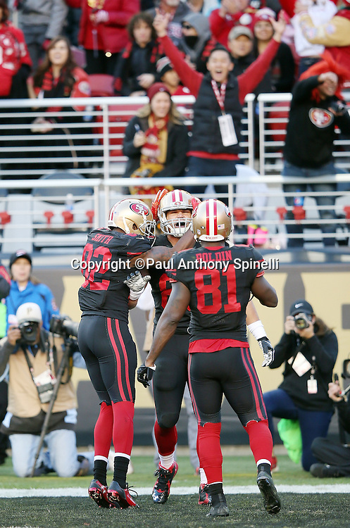 San Francisco 49ers tight end Vance McDonald (89) celebrates with San Francisco 49ers wide receiver Anquan Boldin (81) and San Francisco 49ers wide receiver Torrey Smith (82) after McDonald catches an 8 yard third quarter touchdown pass that cuts the Arizona Cardinals lead to 13-10 during the 2015 week 12 regular season NFL football game against the Arizona Cardinals on Sunday, Nov. 29, 2015 in Santa Clara, Calif. The Cardinals won the game 19-13. (©Paul Anthony Spinelli)