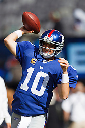 Oct 16, 2011; East Rutherford, NJ, USA; New York Giants quarterback Eli Manning (10) warms up before the game against the Buffalo Bills at MetLife Stadium. Mandatory Credit: Jason O. Watson-US PRESSWIRE