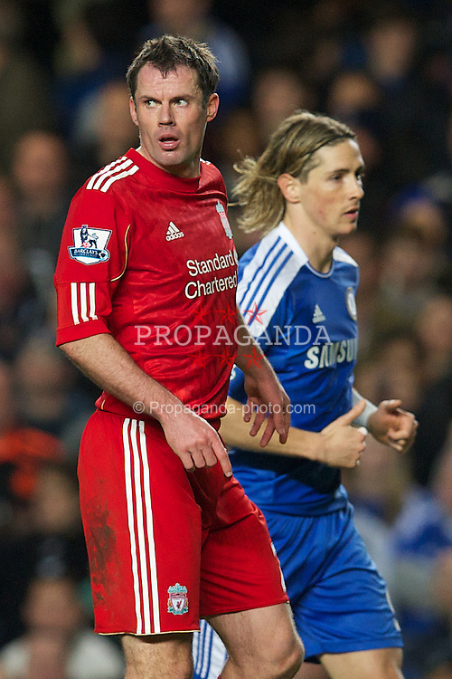 LONDON, ENGLAND - Tuesday, November 29, 2011: Liverpool's Jamie Carragher in action against Chelsea's Fernando Torres during the Football League Cup Quarter-Final match at Stamford Bridge. (Pic by David Rawcliffe/Propaganda)