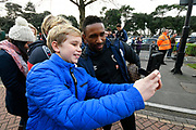 Jermain Defoe (18) of AFC Bournemouth has a selfie with a young fan as he arrives at the Vitality Stadium before the Premier League match between Bournemouth and Liverpool at the Vitality Stadium, Bournemouth, England on 8 December 2018.