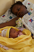 Mother and new born baby on the ward, Uganda.