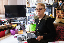 Widow Ann Anderson who had her partially toothless little Yorkshire Terrier Albert 'arrested' by the police after it was alleged her dog had attacked a post office worker monitors a 60,000 signature petition on her laptop calling for her to be reunited with her pet.. PICTURED. London, September 10 2018.