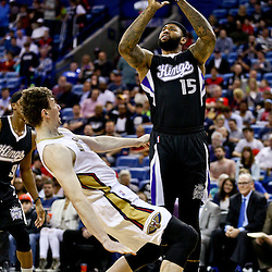 Mar 7, 2016; New Orleans, LA, USA; Sacramento Kings center DeMarcus Cousins (15) shoots over New Orleans Pelicans center Omer Asik (3) during the first quarter of a game at the Smoothie King Center. Mandatory Credit: Derick E. Hingle-USA TODAY Sports