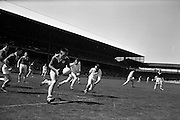 09/06/1963<br /> 06/09/1963<br /> 09 June 1963<br /> Kildare v Louth, Leinster Football quarter final at Croke park, Dublin. M. Murray, Louth right half back, closely watched by Kildare forwards, P. Moore and J. McNally, as he clears in front of his own goalmouth.