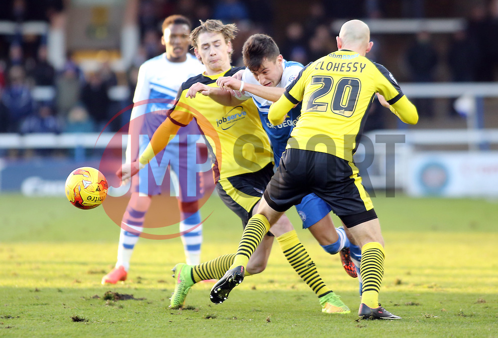 Peterborough United's Joe Newell is stopped by Colchester United's Elliott Hewitt and Sean Clohessy - Photo mandatory by-line: Joe Dent/JMP - Mobile: 07966 386802 - 10/01/2015 - SPORT - Football - Peterborough - ABAX Stadium - Peterborough United v Colchester United - Sky Bet League One