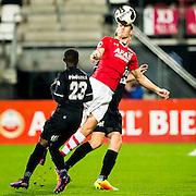 ALKMAAR - 26-10-2016, AZ - FC Emmen, AFAS Stadion, 1-0, FC Emmen speler Issa Kallon, AZ speler Stijn Wuytens