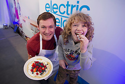 NO REPRO FEE: (L-R) Evan Furlong (8) is pictured with Celebrity MasterChef winner David Gillick who was cooking up a storm at the Electric Ireland stand at the 2013 National Ploughing Championships yesterday. With three showcase demonstrations each day, David is creating some of his favourite healthy dishes for visitors to the Electric Ireland stand. Picture Andres Poveda