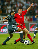 Photograph: Scott Heavey.<br />Ajax Amsterdam v Liverpool. Amsterdam Cup at The Amsterdam ArenA. 01/08/2003.<br />Jamie Carragher keeps a close eye on Wamberto.