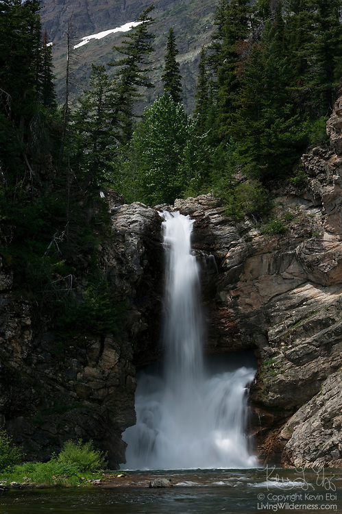 "Running Eagle Falls in Glacier National Park, Montana, is also known as ""Trick Falls"" as the waterfall is much larger at the bottom than it is at the top. The waterfall is located in the Two Medicine area of the park and the ""trick"" is usually visible only in the summer when the water fall is lower."