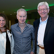 February 28, 2014, Palm Springs, California: <br /> Guests pose for a photograph with John McEnroe during the McEnroe Challenge for Charity VIP Draw Ceremony in the newly constructed Stadium 2 at the Indian Wells Tennis Garden. <br /> (Photo by Billie Weiss/BNP Paribas Open)