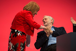 © Licensed to London News Pictures . 28/09/2015 . Brighton , UK . GLENIS WILLMOTT shakes hands with JEREMY CORBYN after speaking at the 2015 Labour Party Conference . Photo credit : Joel Goodman/LNP