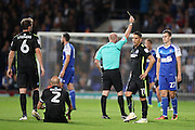 Ipswich Town midfielder Tom Lawrence (27) is shown a yellow card, booked during the EFL Sky Bet Championship match between Ipswich Town and Brighton and Hove Albion at Portman Road, Ipswich, England on 27 September 2016.
