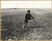 In the Hungarian Steppe | Boy leans on stick