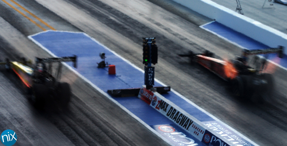 Two Top fuel dragsters race during the Carolinas Nationals at zMAX Dragway @ Concord Sunday, September 14, 2008. (photo by James Nix)