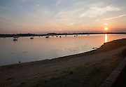 Orange glow of sun setting on the River Deben, Ramsholt, Suffolk, England, UK