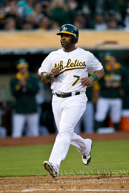 OAKLAND, CA - JULY 05:  Alberto Callaspo #7 of the Oakland Athletics scores a run against the Toronto Blue Jays during the fourth inning at O.co Coliseum on July 5, 2014 in Oakland, California. (Photo by Jason O. Watson/Getty Images) *** Local Caption *** Alberto Callaspo