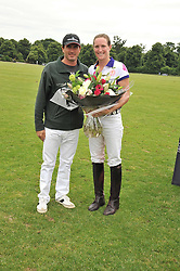 ADOLFO CAMBIASO and NINA CLARKIN at a charity polo match organised by Jaeger Le Coultre was held at Ham Polo Club, Richmond, Surrey on 12th June 2009.