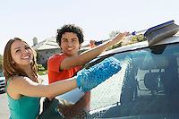 Young couple washing car
