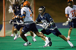 Georgetown Hoyas M Garrett Wilson (22) on Virginia Cavaliers M Shamel Bratton (1).  The Virginia Cavaliers men's lacrosse team faced the Georgetown Hoyas in a Fall Ball Scrimmage held at the University Hall Turf Field in Charlottesville, VA on October 12, 2007.