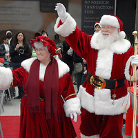 "Mr. and Mrs. Santa Claus greet guests at Santa Monica Place during 'Breakfast with Santa"" on Saturday, December 4, 2010."