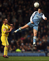 Photo: Paul Thomas.<br /> Manchester City v Sheffield Wednesday. The FA Cup. 16/01/2007.<br /> <br /> Joey Barton (R) of Man City wins the header from Kenny Lunt.