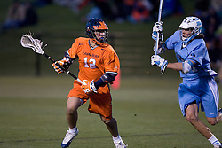 Virginia Cavaliers M Drew Thompson (12) in action against UNC.  The Virginia Cavaliers Men's Lacrosse Team defeated the North Carolina Tar Heels 10-9 in overtime at Klockner Stadium in Charlottesville, VA on April 7, 2007.