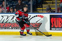 KELOWNA, BC - OCTOBER 2:  Kyle Topping #24 of the Kelowna Rockets skates with the puck against the Tri-City Americans  at Prospera Place on October 2, 2019 in Kelowna, Canada. (Photo by Marissa Baecker/Shoot the Breeze)