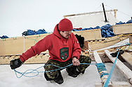 At a camp in Baring Bay off Devon Island, an Inuit Rangers, tied up a komatik, a freight sled towed by the snowmobiles. They are still made of wood and ropes for enduring flexibilty and easiness  to repair.  22 April 2012.