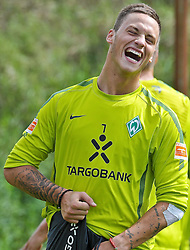 30.07.2010, Thermenstadion, Bad Waltersdorf, AUT, Trainingslager Werder Bremen 1. FBL 2010 - Day03 im Bild      Marko Arnautovic (Werder #07 ) lacht hat Spass beim Training EXPA Pictures © 2010, PhotoCredit: EXPA/ nph/  Kokenge+++++ ATTENTION - OUT OF GER +++++ / SPORTIDA PHOTO AGENCY