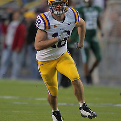 Oct 31, 2009; Baton Rouge, LA, USA; LSU Tigers tight end Richard Dickson (18) during warm ups prior to kickoff against the Tulane Green Wave at Tiger Stadium. LSU defeated Tulane 42-0. Mandatory Credit: Derick E. Hingle