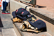 Hats and gloves of the Minnesota Twins players sit on the steps of their dugout during a game against the Cleveland Indians at Target Field in Minneapolis, Minnesota on July 29, 2012.  The Twins defeated the Indians 5 to 1.  © 2012 Ben Krause