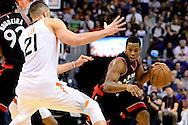 Dec 29, 2016; Phoenix, AZ, USA;  Toronto Raptors guard Kyle Lowry (7) handles the ball in front of Phoenix Suns center Alex Len (21) in the first half of the NBA game at Talking Stick Resort Arena. Mandatory Credit: Jennifer Stewart-USA TODAY Sports