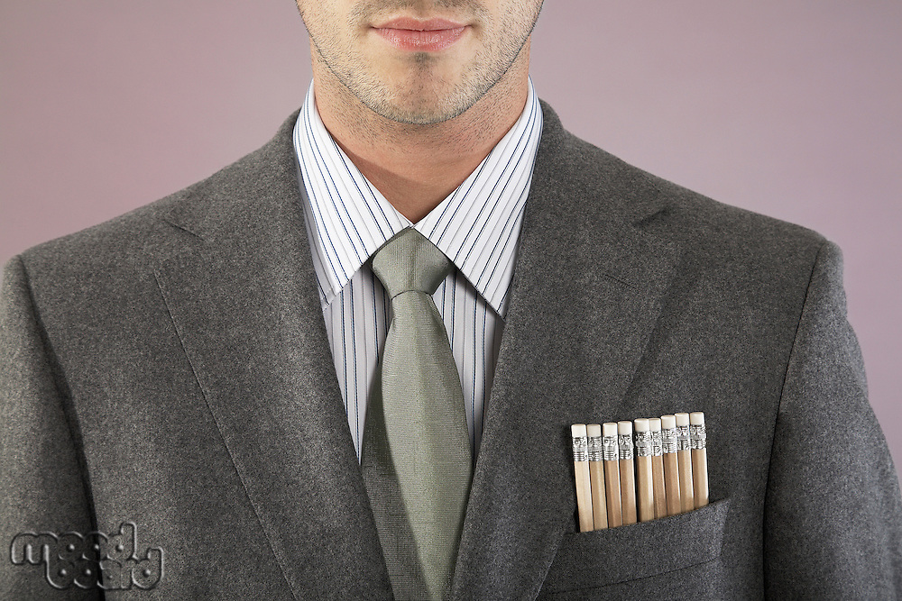 Young businessman with pencils in pocket close-up portrait