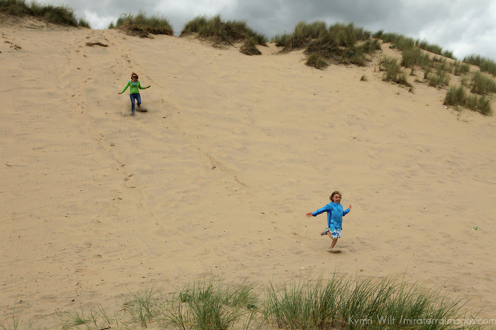 Europe, Ireland, Brittas Bay. Enjoying the steep dune of Brittas Bay.