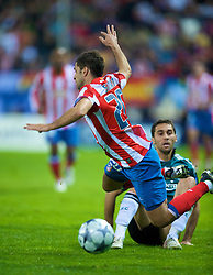 MADRID, SPAIN - Wednesday, October 22, 2008: Club Atletico de Madrid's Simao is tackled by Liverpool's Alvaro Arbeloa during the UEFA Champions League Group D match at the Vicente Calderon. (Photo by David Rawcliffe/Propaganda)