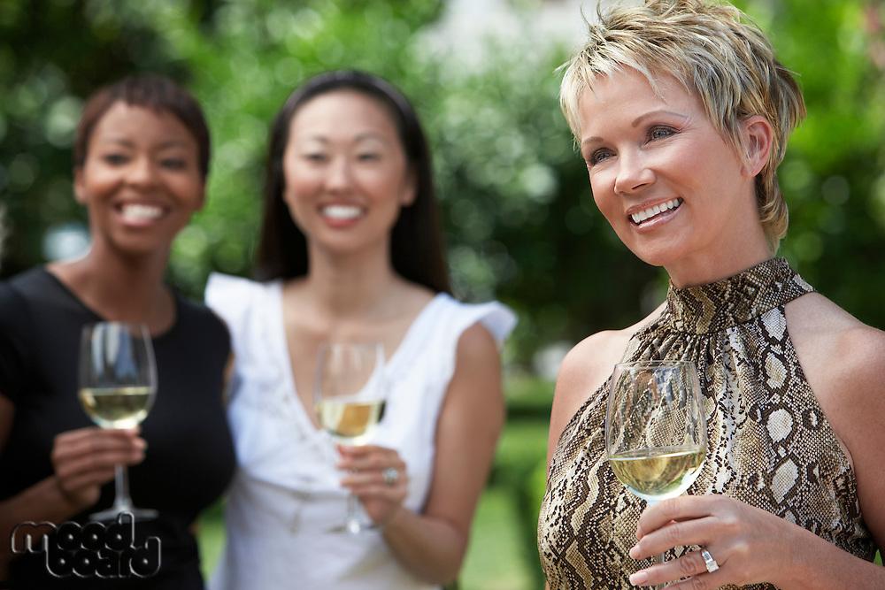 Three Women Celebrating in Garden