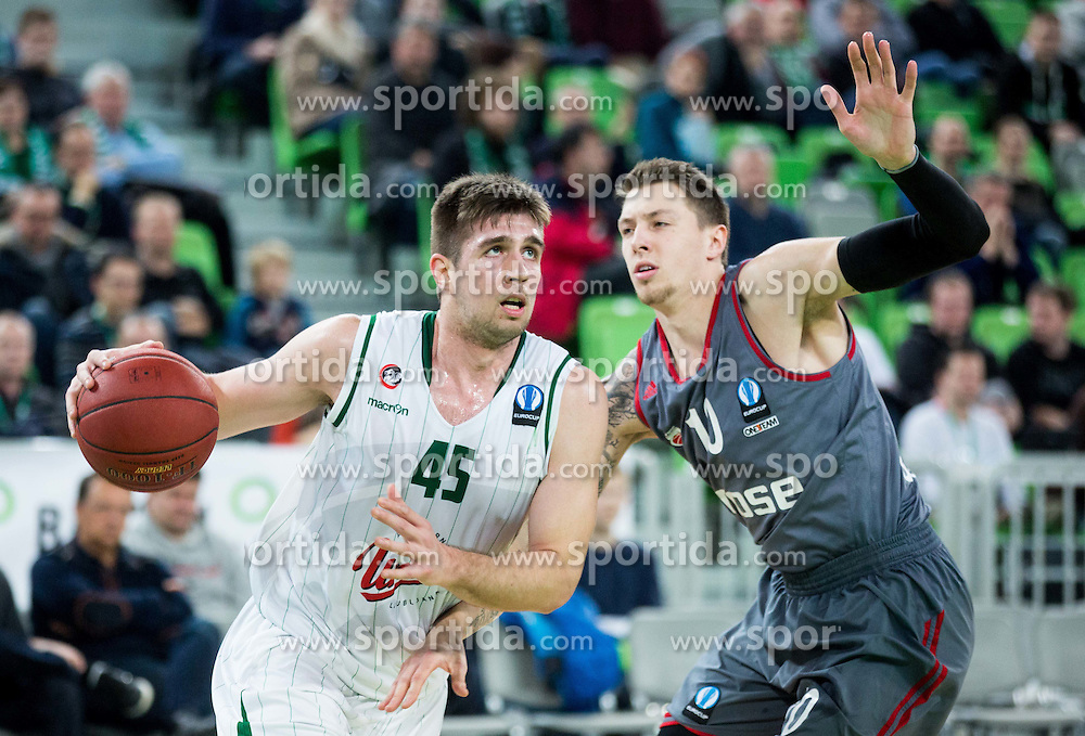 Halil Kanacevic #45 of KK Union Olimpija vs Daniel Theis of Brose Baskets Bamberg   during basketball match between KK Union Olimpija Ljubljana (SLO) and Brose Baskets Bamberg (GER) in 1st Round of EuroCup LAST32, on January 7, 2015 in Arena Stozice, Ljubljana, Slovenia.  Photo by Vid Ponikvar / Sportida