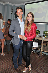 KATIE READMAN and TOM WARREN at a evening with fashion label Lilah held at Quo Vadis, 26-29 Dean Street, London W1 on 29th May 2013.