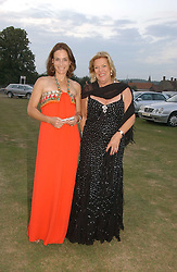 Left to right, MELANIE VERE NICOLL and ROS PACKER at the Cowdray Gold Cup Golden Jubilee Ball held at Cowdray Park Polo Club, on 21st July 2006.<br />