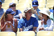 LOS ANGELES, CA - JULY 13:  Fans talk at their seats before the Los Angeles Dodgers game against the San Diego Padres at Dodger Stadium on Sunday, July 13, 2014 in Los Angeles, California. The Dodgers won the game 1-0. (Photo by Paul Spinelli/MLB Photos via Getty Images)