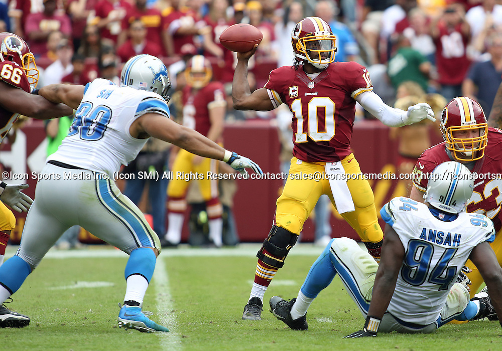 September 22, 2013: Washington Redskins Quarterback Robert Griffin III (10) throws in a cluttered pocket during a regular season match between the Detroit Lions and the Washington Redskins at FedEx Field in Landover, Maryland.
