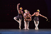 A group of male dancers in female roles hams it up in this performance of Les Ballets Trockadero de Monte Carlo.