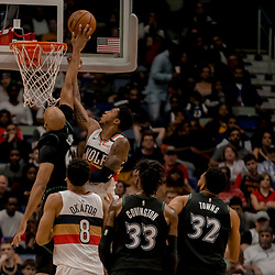 Dec 31, 2018; New Orleans, LA, USA; Minnesota Timberwolves forward Taj Gibson (67) blocks a shot by New Orleans Pelicans guard Elfrid Payton (4) during the second quarter at the Smoothie King Center. Mandatory Credit: Derick E. Hingle-USA TODAY Sports