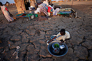 Returnees from Khartoum prepare dinner in Abyei on Jan. 12, 2011.