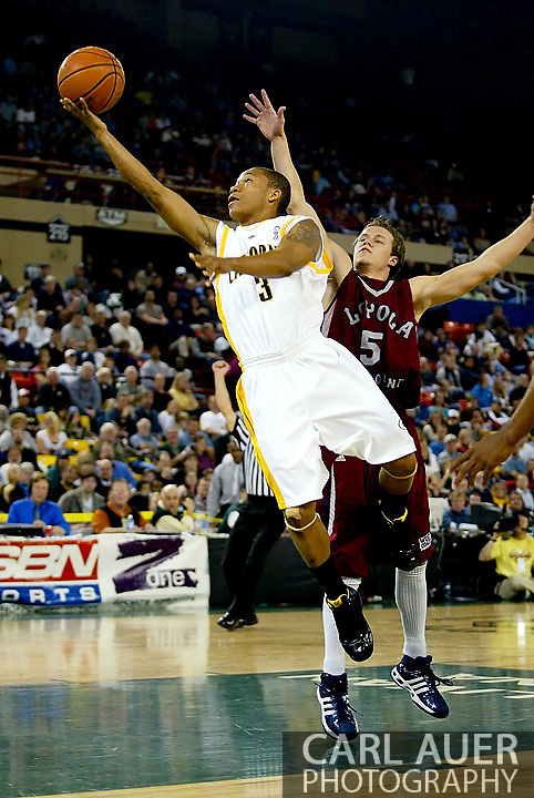11/25/2006 - Anchorage, Alaska: Showing his speed, Freshman guard Jerome Randle (3) of the California Golden Bears flashes past Senior guard John Montgomery (5) of the Loyola Marymount Lions into the lane for a shot as the California Golden Bears hold off LMU 78-70 to capture the championship title of the 2006 Great Alaska Shootout<br />