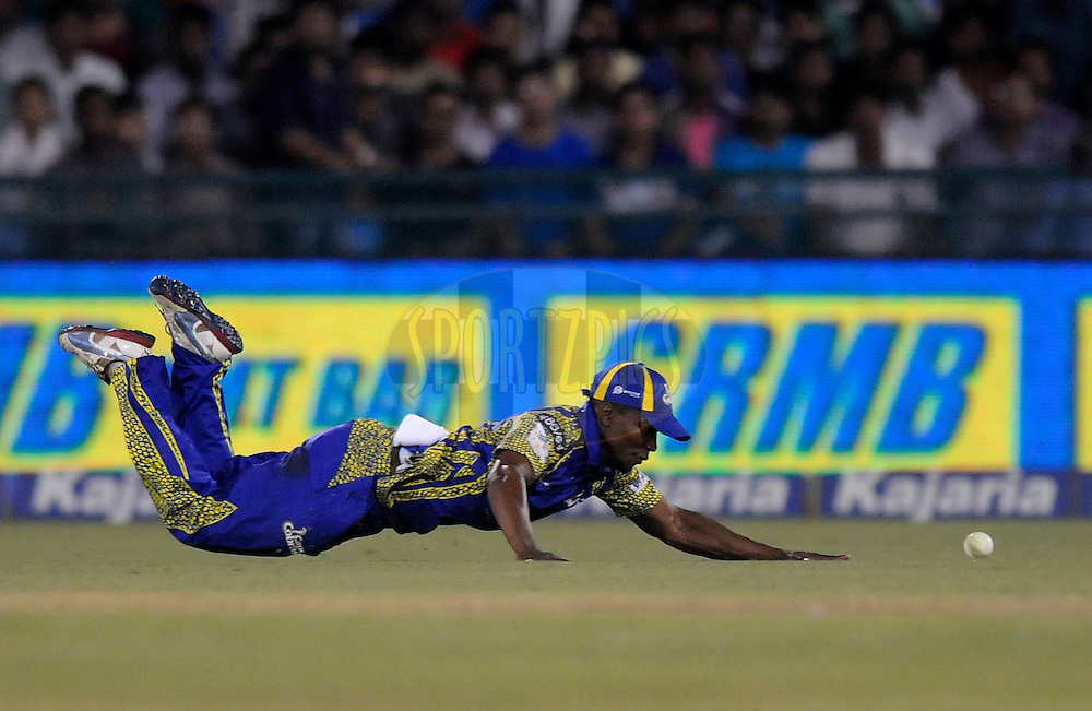 Omphile Ramela of Cape Cobras tries to stop a ball during match 3 of the Oppo Champions League Twenty20 between the Cape Cobras and the Northern Knights held at the Chhattisgarh International Cricket Stadium, Raipur, India on the 19th September 2014<br /> <br /> Photo by:  Pal Pillai / Sportzpics/ CLT20<br /> <br /> <br /> Image use is subject to the terms and conditions as laid out by the BCCI/ CLT20.  The terms and conditions can be downloaded here:<br /> <br /> http://sportzpics.photoshelter.com/gallery/CLT20-Image-Terms-and-Conditions-2014/G0000IfNJn535VPU/C0000QhhKadWcjYs